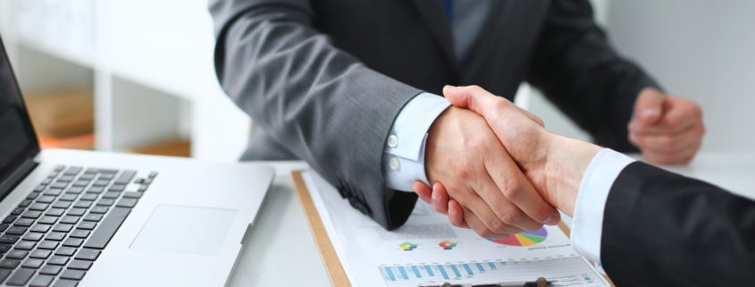 Business handshake. Business people shaking hands, finishing up a meeting