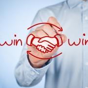 Win-win partnership strategy concept. Businessman draw win-win scheme and handshake partnership agreement.